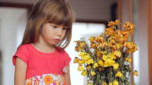 little gir with wilted flowers-1